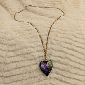 Murano glass heart pendant on gold chain.